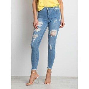Distressed blue denim skinny jeans